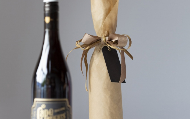 6 steps to gift wrapping a bottle in tissue paper
