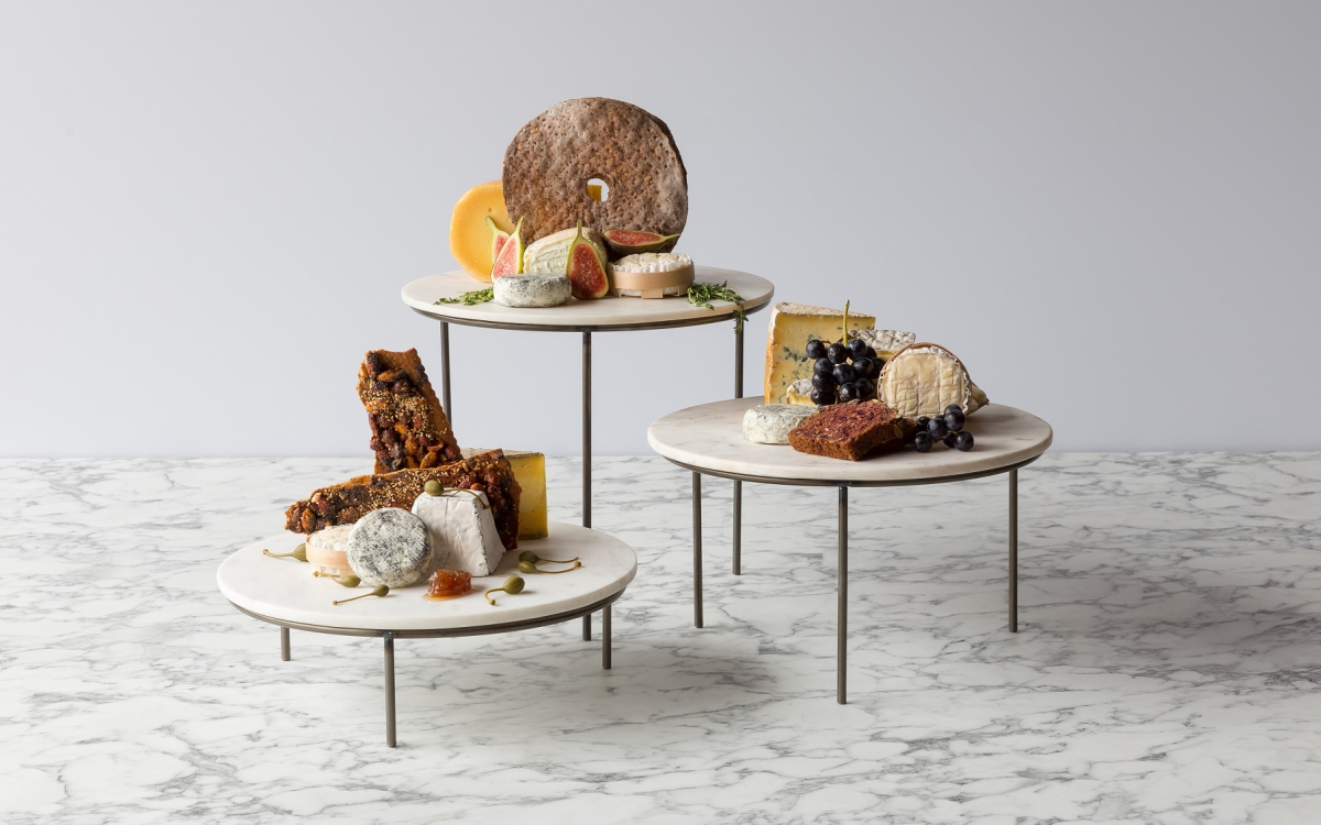 light grey / white marble risers displaying cheese